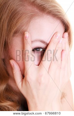 Shy Afraid Woman Peeking Through Fingers Isolated.