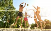 Group young Friends Playing Volleyball On Beach poster