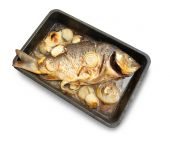Grilled carp fish on the cook griddle. Isolated with clipping path poster