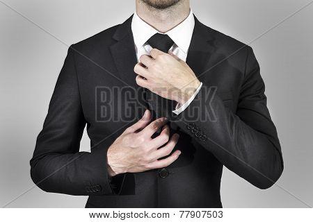 Businessman Correcting His Tie