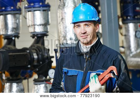 industrial construction worker plumber  at boiler room