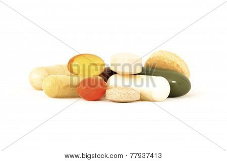 Various vitamins and herbal supplements on white background poster