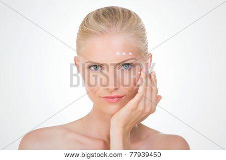 Nordic Girl Applying Salve On Her Face