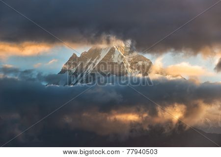 Himalayan snow mountain obscured by clouds