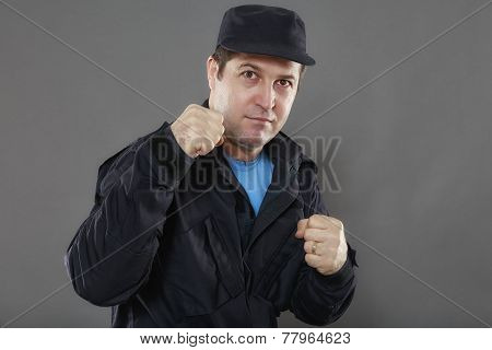 Security guard attack position isolated on gray background poster
