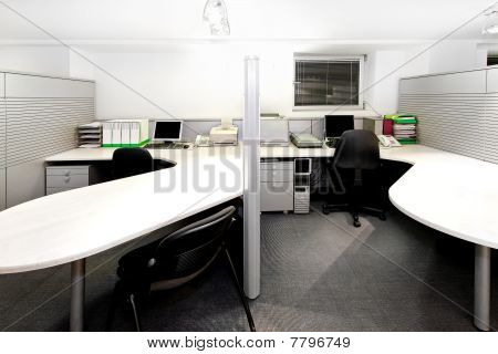 Modern office cubicles divided with folding screens poster