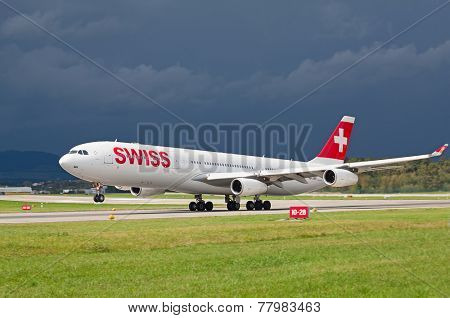 ZURICH - SEPTEMBER 21: Swiss Air A-340 taking off on September 21, 2014 in Zurich, Switzerland. Zurich airport is home port for Swiss Air and one of the biggest european hubs.