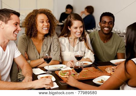 Group Of Friends Laughing In A Restaurant
