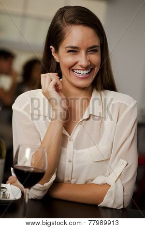 Beautiful Woman Laughing In A Restaurant