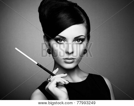 Portrait of beautiful sensual woman with elegant hairstyle. Woman with cigarette Perfect makeup. Fashion photo. Black and white photo poster