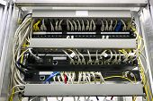 connected switches in technology room with fiber optic SFP ports poster