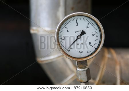 Pressure gauge on oil and gas process for monitored condition.