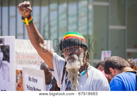 Man With Beard Raising Hand For Justice