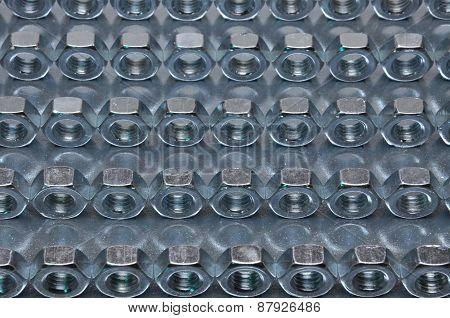 Nuts on sheet surface in regular pattern