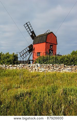 Windmill with stone wall In Oland, Sweden