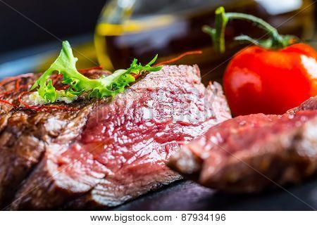 Grilled Beef steak with vegetable decoration. Grilled porterhouse steak