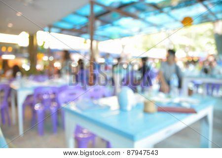 Blur Or Defocus Image Of Outdoor Restaurant With Garden In Background