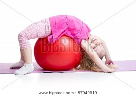 Cute Kid Girl Stretching On Pilates Ball
