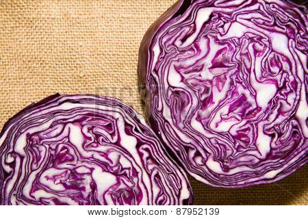 The Fruit Of Red Cabbage Cut With A  Knife