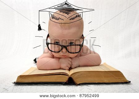 Cute Little Baby In Glasses With Painted Professor Hat