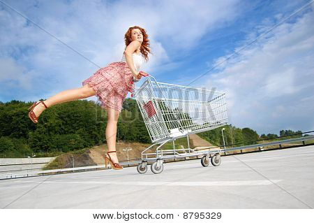 Shopping woman holding trolley