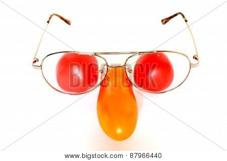Funny face composition with tomatoes and glasses