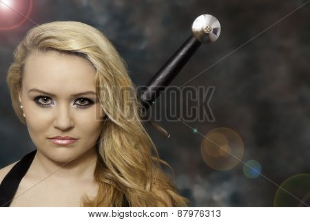Attractive blonde woman with a sword
