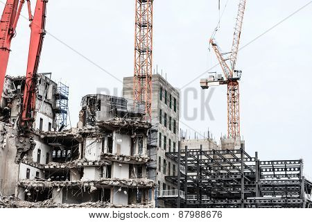 Urban scene. Dismantling of a house. Building demolition and crashing by machinery for new construction. Industry. poster