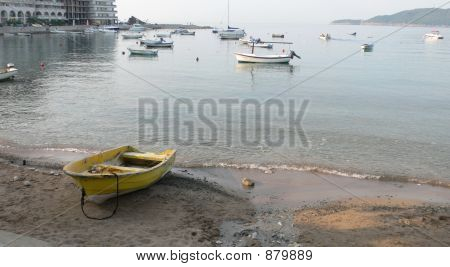 A Yellow Boat On The Sand