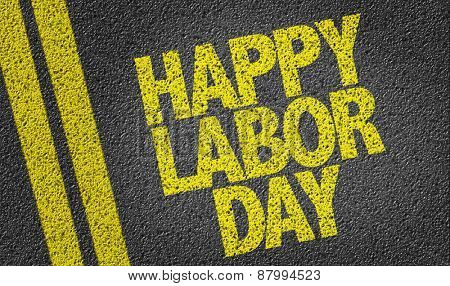 Happy Labour Day written on the road poster