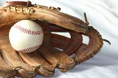 ball and glove on a white background poster