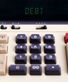 Old calculator showing a text on display - debit poster