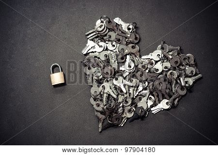 a bunch of keys arranged as a heart shape with a small security lock