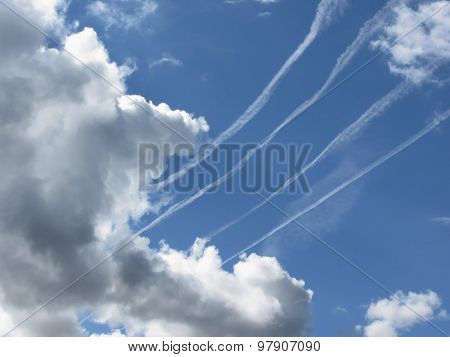 Contrails Of Aircraft And Giants Cumulonimbus Clouds In The Blue Sky