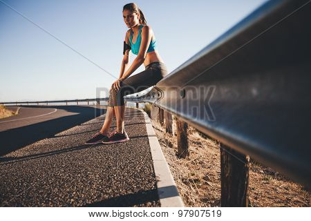 Young Female Runner Taking A Break