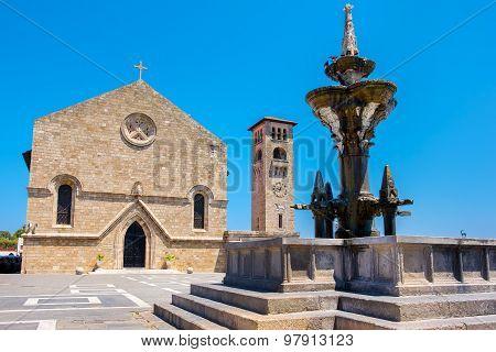 Fountain And Church. Rhodes, Greece
