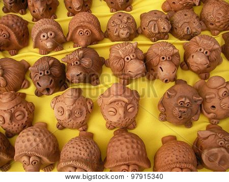 Clay toys animal, moneyboxes, penny whistles are on sale at cheerful fairs