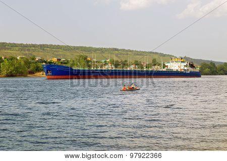 cargo ship tanker sailing along the coast.