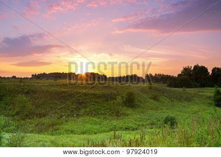 green meadow ravine sunset.