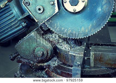 old circular saw in a metal workshop