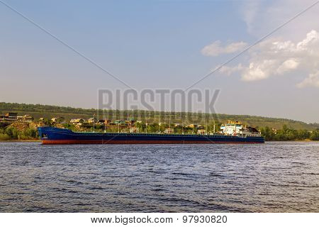 cargo ship tanker sailing along the coast. poster