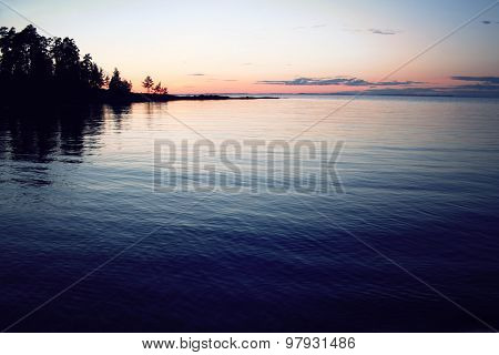 Trees Reflected In The Water. Beautiful Northern Landscape.