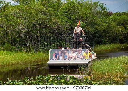 Tourists Riding An Airboat In The Everglades