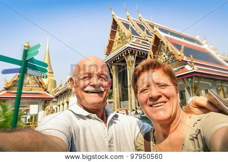 Senior Happy Couple Taking A Selfie At Grand Palace Temples In Bangkok - Thailand Adventure Travel