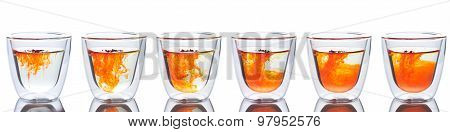 orange color spread in glass of water