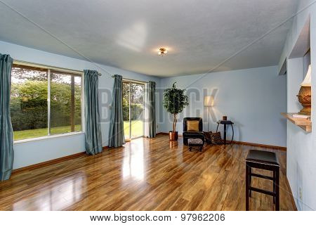 Secondary Living Room With Blue Interior And Hardwood Floor.