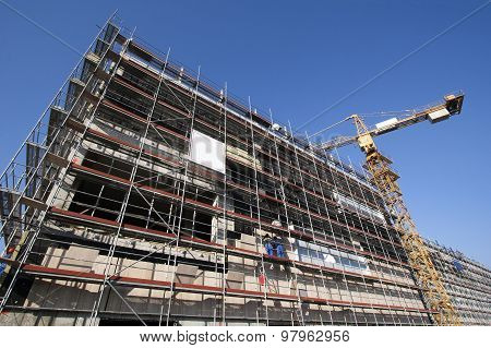 Scaffolding and crane