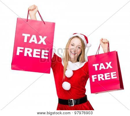 Woman with christmas party dress hold up with shopping bag and showing tax free