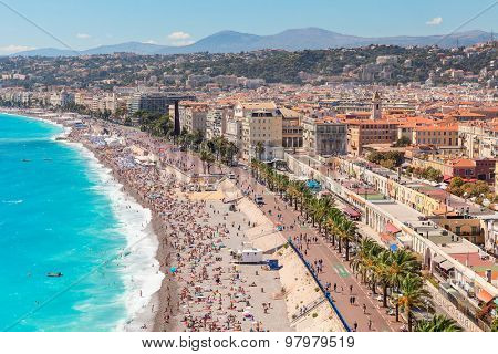 NICE, FRANCE - AUGUST 23, 2014: View on promenade Anglais in Nice - fifth most populous, second-largest on French Mediterranean coast and one of most visited cities with 4 million tourists every year.