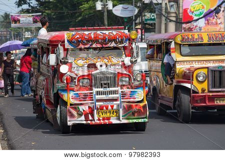 Jeepneys Passing, Filipino Inexpensive Bus Service. Philippines.